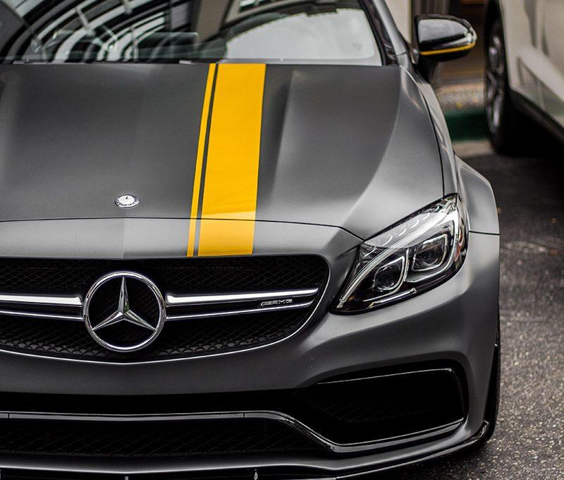 Matt grey Mercedes sports car with yellow stripe
